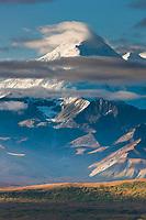 Clouds cap Mt Brooks of the Alaska range in Denali National Park, Alaska.