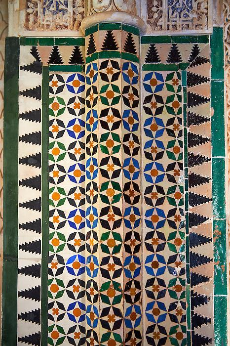 Moorish arabesque ceramic tiles sculpted plasterwork of the Palacios Nazaries,  Alhambra. Granada, Andalusia, Spain.