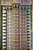 Moorish arabesque ceramic tiles sculpted plasterwork of the Palacios Nazaries,  Alhambra. Granada, Andalusia, Spain.