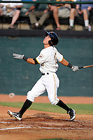 Center fielder Eduardo Figueroa (13) of the Bristol Pirates bats in a game against the Greeneville Astros on Saturday, July 26, 2014, at DeVault Memorial Stadium in Bristol, Virginia. Greeneville won, 2-1 in Game 1 of a doubleheader. (Tom Priddy/Four Seam Images)