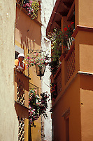 Young woman blowing a kiss from a balcony in the Callejon del Beso or Alley of the Kiss in the city of Guanajuato, Mexico