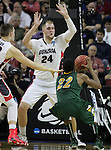 North Dakota State's Kory Brown (22) finds his way to the basket blocked by Gonzaga's Przemel Karnowski (24) and Kyle Wiltjer (11) while going to the basket during the 2015 NCAA Division I Men's Basketball Championship's March 20, 2015 at the Key Arena in Seattle, Washington.©2015. Jim Bryant Photo. ALL RIGHTS RESERVED.