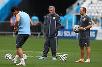 Uruguay coach Oscar Tabarez watches Luis Suarez as he trains in the Arena Corinthians, Sao Paulo ahead of his sides Group D crunch fixture vs England tomorrow