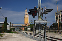 Old miami downtown view of old city hall tower and train-tracks in the foreground