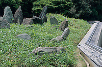 Large stones and a bamboo thicket make up one of the gardens at Matsunoo Taisha shrine.