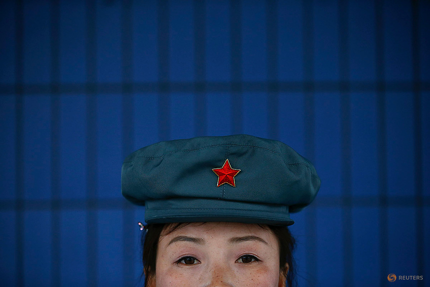 A guard secures gates of a catfish farm visited by a group of foreign reporters in Pyongyang, North Korea April 17, 2017.    REUTERS/Damir Sagolj