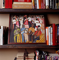 Detail of a small painting on a bookshelf