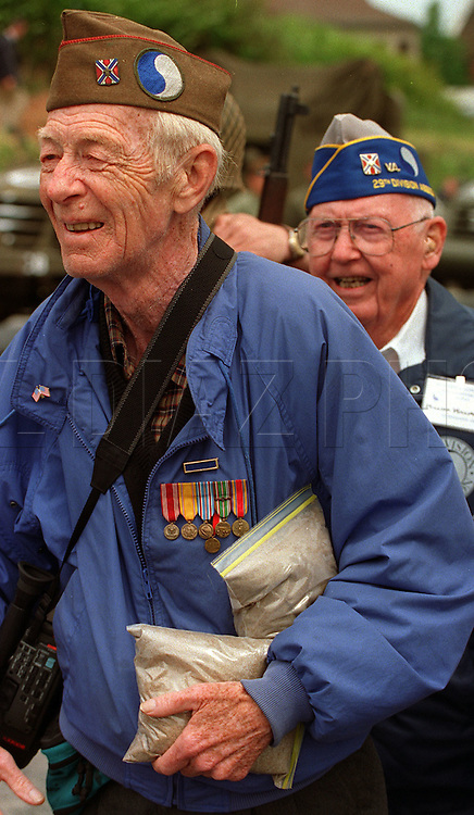 June 3, 1994, Al Diaz/Herald Staff--A veteran of the US Armies 29th Infantry Division, carries bags of sand taken from Omaha Beach, Normandy, France on the 50th Anniv. of D-Day.