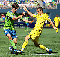 Seattle Sounders FC midfielder Alvaro Fernandez, left, and Columbus Crew defender Josh Gardner battle for the ball at CenturyLink Field in Seattle Saturday Aug. 27, 2011. The Sounders FC won the game 6-2.