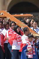 Pope Francis leads the Palm Sunday Mass at St Peter Square - Youngs coming from Panama raises the Cross of the WYD at the end of the Palm Sunday Mass in St Peter Square at the Vatican April 9, 2017. _