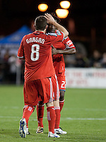 Dan Gargan (8) goes to celebrate with Amadou Sanyang (22) after the game. Toronto FC defeated the San Jose Earthquakes 3-1 at Buck Shaw Stadium in Santa Clara, California on May 29th, 2010.