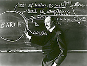 Doctor Robert H. Goddard at a blackboard at Clark University in Worcester, Massachusetts, in 1924. Goddard began teaching physics in 1914 at Clark and in 1923 was named the Director of the Physical Laboratory. In 1920 the Smithsonian Institution published his seminal paper A Method for Reaching Extreme Altitudes where he asserted that rockets could be used to send payloads to the Moon. Declaring the absurdity of rockets ever reaching the Moon, the press mocked Goddard and his paper, calling him &quot;Moon Man.&quot; To avoid further scrutiny Goddard eventually moved to New Mexico where he could conduct his research in private. Doctor Goddard, died in 1945, but was probably as responsible for the dawning of the Space Age as the Wrights were for the beginning of the Air Age. Yet his work attracted little serious attention during his lifetime. However, when the United States began to prepare for the conquest of space in the 1950's, American rocket scientists began to recognize the debt owed to the New England professor. They discovered that it was virtually impossible to construct a rocket or launch a satellite without acknowledging the work of Doctor Goddard. .Credit: NASA via CNP