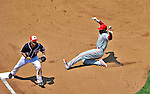 30 May 2011: Philadelphia Phillies outfielder Domonic Brown slides safely into third during game action against the Washington Nationals at Nationals Park in Washington, District of Columbia. The Phillies defeated the Nationals 5-4 to take the first game of their 3-game series. Mandatory Credit: Ed Wolfstein Photo
