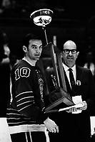California Golden Seals Ted Hampson getting trophy from Oakland Tribune Sports Editor George Ross.<br />
