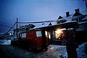Kotowice 01.2010 Poland<br /> Only grocery stores can afford to aggregators. They are therefore the only source of light in the village.<br /> Three atmospheric forces: rain, snow and frost have changed into an ecological disaster the Myszkowski district in the Czestochowskie province, located 230 kilometers south of Warsaw. Almost 95% of all trees are down.Thousands of homes are left without electricity.<br /> Photo: Adam Lach / Napo Images for Newsweek Polska<br /> <br /> Tylko sklepy spozywcze stac na agregatory. Sa w tedy jedynym zr&oacute;dlem swiatla w wioseczce.<br /> Wstepnie &quot;tylko&quot; 95% scietych drzew w dwoch powiatach. 0.5 miliona metrow szesciennych zniszczonych lasow..Tysiace gospodarstw bez pradu. Wszyscy maja swiadomosc, ze na kumulacje trzech niekorzystnych .zjawisk atmosferycznych rady nie ma.Trzy zjawiska kt&oacute;re zamienily jeden z obszarow Polski w istna katastrofe ekologiczna: deszcz, snieg i szadz.<br /> Fot: Adam Lach / Napo Images dla Newsweek Polska