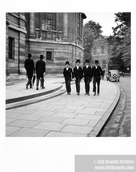 Eton boys four abreast outside School Hall, June, 1933