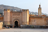 Low angle view of Bab el-Mahrouk, 1214, the gate to the Medina, Fez, Morocco, pictured on February 25, 2009 in the morning. In front of the ancient gate, Built by the Almohads during the reign of Mohammad El-Nasser, it is now surrounded by market stalls. Fez, Morocco's second largest city, and one of the four imperial cities, was founded in 789 by Idris I on the banks of the River Fez. The oldest university in the world is here and the city is still the Moroccan cultural and spiritual centre. Fez has three sectors: the oldest part, the walled city of Fes-el-Bali, houses Morocco's largest medina and is a UNESCO World Heritage Site;  Fes-el-Jedid was founded in 1244 as a new capital by the Merenid dynasty, and contains the Mellah, or Jewish quarter; Ville Nouvelle was built by the French who took over most of Morocco in 1912 and transferred the capital to Rabat. Picture by Manuel Cohen.