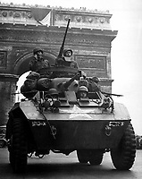 &quot;We couldn't stick around long though.  The Jerries were on the run and we wanted to keep them that way.  The Tricolor flying from the Arc de Triomphe looked pretty good as we went through.&quot;  American tank in Paris, August 1944.  (OWI)<br /> Exact Date Shot Unknown<br /> NARA FILE #:  208-YE-68<br /> WAR &amp; CONFLICT BOOK #:  1051