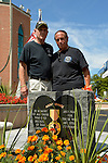 East Meadow, New York, U.S. - September 3, 2014 - L-R, PAT YNGSTROM, of Merrick, U.S. Army Paratrooper, Vietnam War Veteran, and STEVE BONOM, of Massapequa, U.S. Navy, Vietnam War Veteran, are standing behind the Agent Orange Monument at Eisenhower Park, after participating in a press conference held by congressionaly candidate K. Rice. They are members of Rice's newly formed Veterans Advisory Committee, and casualties of Agent Orange during the Vietnam War.