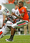 The University of Miami vs Virginia Cavaliers at Land Shark Stadium on Saturday November 7...Virginia linebacker Cam Johnson (56) face masksand rips the helmet off Miami's quarterback Jacory Harris (12) in the third quarter.
