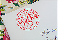 BNPS.co.uk (01202 558833)<br /> Pic: TomWren/BNPS<br /> <br /> The Lover stamp which is added to the front of every Valentine's Day card that is posted at the Lover pop-up post office.<br /> <br /> A British village is cashing in on the cupid effect this Valentine's Day by launching its own postal service so anyone can send a card from the 'world's most romantic village'.<br /> <br /> The tiny village of Lover in Wiltshire has launched the 'Lover Post' with limited edition cards and a special post mark showing it has been sent from the tender-hearted village.<br /> <br /> The quirky gimmick is part of a campaign to save the once-thriving village for the local community.