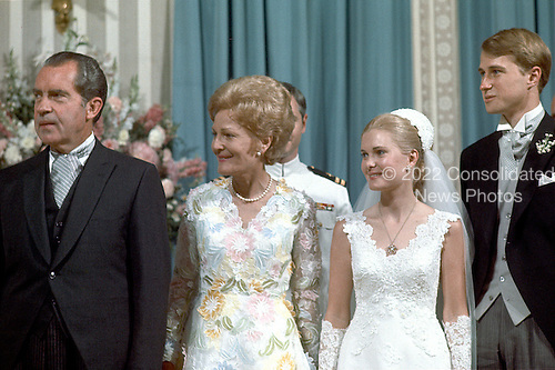 Washington, DC - June 12, 1971 -- United States President Richard M. Nixon, left, first lady Pat Nixon, center left, newlyweds Tricia Nixon Cox, center right, and Edward Cox, right, stand in the receiving line at the White House in Washington, D.C. on Saturday, June 12, 1971 following the wedding ceremony in the Rose Garden.  .Credit: Pool via CNP