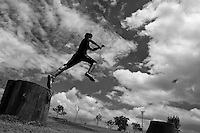A Colombian parkour athlete performs a high jump during a free running training session of Tamashikaze team in a park in Kennedy, Bogotá, Colombia, 21 February 2016. Parkour, originally developed in France during the late 1980s from military training, is a physical activity, focused on the art of movement and overcoming obstacles in a strictly urban environment. Practitioners of parkour employ running, climbing, jumping, rolling and other movements to pass through any urban area the most efficient way possible.