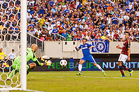 A. C. Milan goalkeeper Christian Abbiati (32) makes a save on Chelsea F. C. midfielder Juan Mata (10). Chelsea F. C. defeated A. C. Milan 2-0 during round two of the 2013 Guinness International Champions Cup at MetLife Stadium in East Rutherford, NJ, on August 04, 2013.