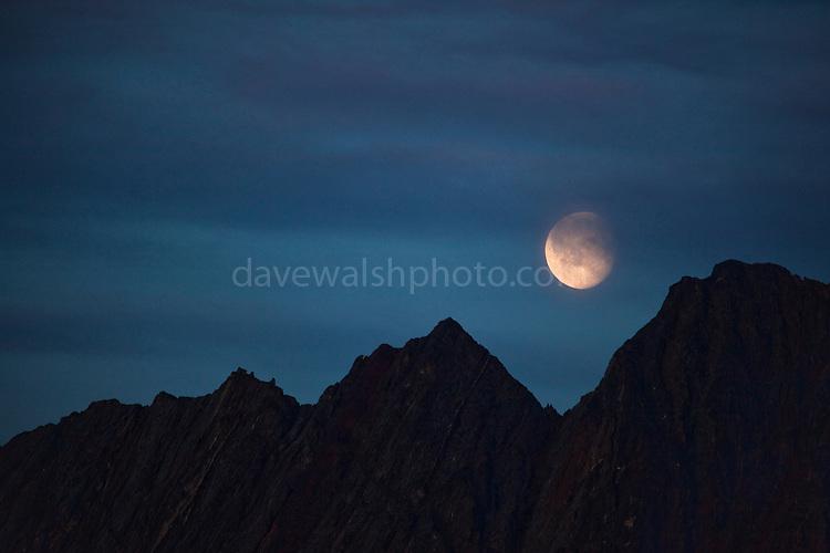 Moon rising over mountains in Nugatsiaq, Baffin Bay, Greenland