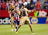 Philadelphia Union midfielder Stefani Miglioranzi (6) heads a ball from the box. The Philadelphia Union and CD Chivas USA played to 1-1 draw at Home Depot Center stadium in Carson, California on Saturday evening July 3, 2010..
