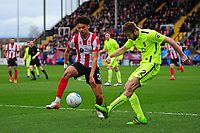 Lincoln City's Lee Angol vies for possession with York City's Shaun Rooney<br /> <br /> Photographer Andrew Vaughan/CameraSport<br /> <br /> Buildbase FA Trophy Semi Final Second Leg - Lincoln City v York City - Saturday 18th March 2017 - Sincil Bank - Lincoln<br />  <br /> World Copyright &copy; 2017 CameraSport. All rights reserved. 43 Linden Ave. Countesthorpe. Leicester. England. LE8 5PG - Tel: +44 (0) 116 277 4147 - admin@camerasport.com - www.camerasport.com