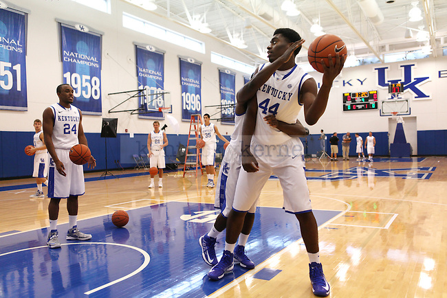 Dakari Johnson being held back while shooting a basket during basketball photo media day in Lexington, Ky., on Thursday, September 12, 2013. Photo by Eleanor Hasken l Staff