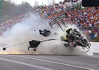 Mar 14, 2015; Gainesville, FL, USA; NHRA top fuel dragster driver Larry Dixon crashes after his car broke in half during qualifying for the Gatornationals at Auto Plus Raceway at Gainesville. Dixon walked away from the incident. Mandatory Credit: Mark J. Rebilas-USA TODAY Sports