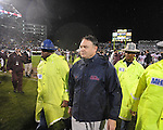 Ole Miss head coach Houston Nutt walks off the field following a 31-3 loss vs. Mississippi State in Starkville, Miss. on Saturday, November 26, 2011. The game was Nutt's last as head coach of the Rebels.