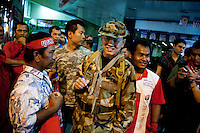 General Khattiya Sawasdipol called Seh Daeng, is signing autographs to militants sunday 18 april. He was shot in the head by a sniper near the barricade May 13 evening, one day before the assault of thai army against the camp. He was one the most mysterious figures of the movement of Red Shirts whom other leaders refuse to accept his radical positions. He was not allowed to speak on the stage to militants and choose to showed off this sunday 18 april  on the evening, in the camp of Ratchaprasong surrounded by his bodyguards.