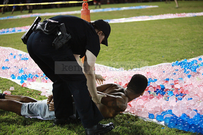 A participant is handcuffed after entering the water balloon area prior to the beginning of the CSF water balloon fight in Lexington, Ky., at Johnson Center field on Friday Sept. 7, 2013. Photo by Emily Wuetcher   Staff