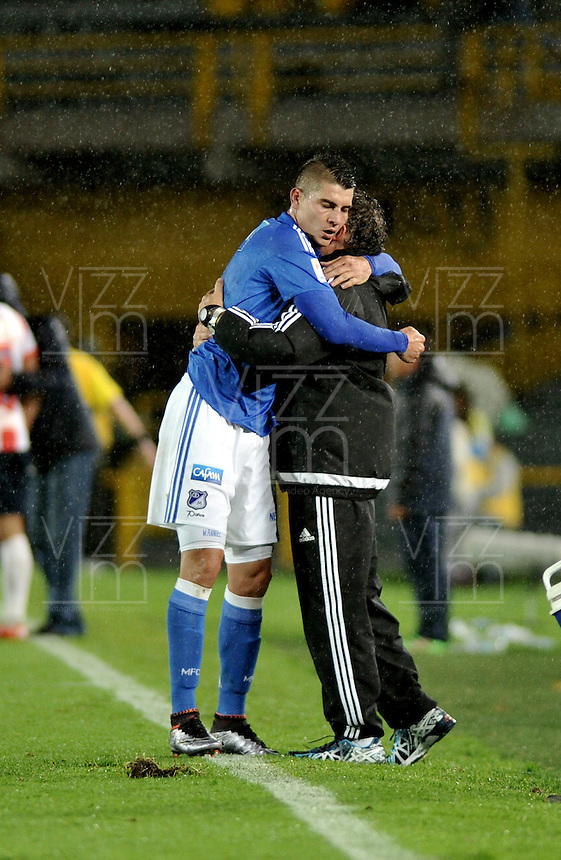 BOGOTA - COLOMBIA -27 - 04 - 2016: Michael Rangel (izq.) jugador de Millonarios, celebra con Ruben Israel (Der.) el gol anotado a Atletico Junior, durante partido de la fecha 15 entre Millonarios y Atletico Junior, de la Liga Aguila I-2016, jugado en el estadio Nemesio Camacho El Campin de la ciudad de Bogota. / Michael Rangel (L) player of Millonarios celebrates with Ruben Israel (R) the scored goal to Atletico Junior, during a match between Millonarios and Atletico Junior, for the 15 date of the Liga Aguila I-2016 at the Nemesio Camacho El Campin Stadium in Bogota city, Photo: VizzorImage / Luis Ramirez / Staff.