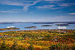 Fall foliage and cruise ships moored in Frenchman Bay in Bar Harbor, ME, USA