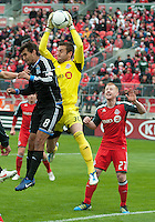 24 March 2012: Toronto FC goalkeeper Milos Kocic #30 and San Jose Earthquakes forward Chris Wondolowski #8 in action during a game between the San Jose Earthquakes and Toronto FC at BMO Field in Toronto..The San Jose Earthquakes won 3-0..