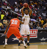 March 11, 2013  (Washington, DC)  Ballou's Dawone Wright #5 survey's the defense of the Coolidge Colts during the inaugural D.C. State Athletics Championship at the Verizon Center March 11, 2013. Coolidge won 69-47.  (Photo by Don Baxter/Media Images International)