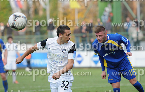 Mate Eterovic #32 of Mura vs Slobodan Vuk #10 of Domzale during football match between NK Mura 05 and NK Domzale in 18th Round of PrvaLiga NZS 2012/13 on November 11, 2012 in Murska Sobota, Slovenia. (Photo By Ales Cipot / Sportida)..