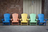 Colored Muskoka chairs are pictured in Ocean Beach on Fire Island in New York state, Wednesday August 3, 2011. The incorporated villages of Ocean Beach and Saltaire within Fire Island National Seashore are car-free during the summer tourist season and permit only pedestrian and bicycle traffic.