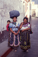 Two prosperous Maya women  in the city of Quetzaltenango, Guatemala