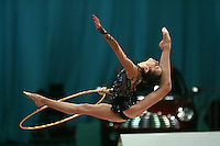 "Daria Kushnerova of Ukraine split leaps with hoop at 2008 World Cup Kiev, ""Deriugina Cup"" in Kiev, Ukraine on March 22, 2008."