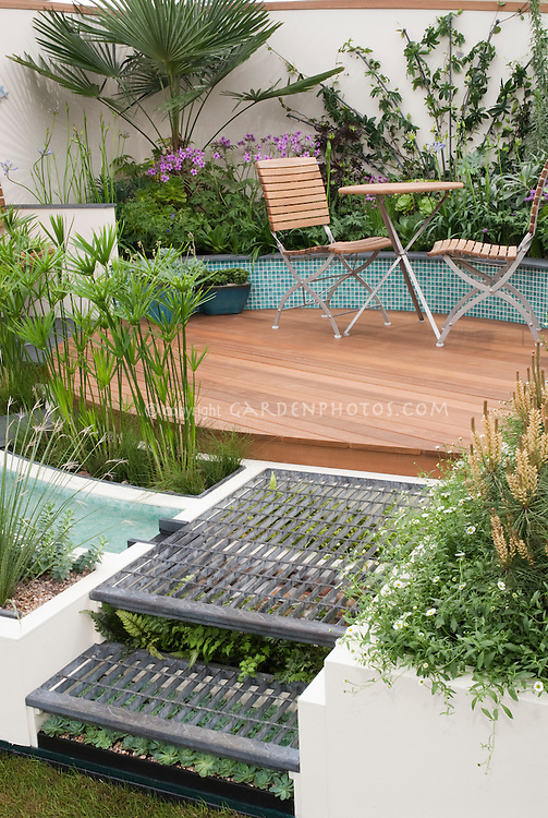 What Plants Will Grow Under A Deck : Circular raised patio and plantings plant flower stock photography