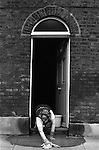 Woman cleaning her home and washing  pavement. Waterloo SE London. England. 1975<br /> <br /> 16x12 PARIS 2015 LES DOUCHES LA GALERIE <br /> <br /> THIS ARE MEDIUM RES FILES ONLY FOR REFERENCE AND SHOULD NOT BE SENT OUT THEY OPEN AT 11MGB