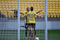 Nathan Burns and Michael Mcglinchey in action during the A League - Wellington Phoenix v Newcastle Jets Game at Westpac Stadium, Wellington, New Zealand on Sunday 26 October 2014. <br /> Photo by Masanori Udagawa. <br /> www.photowellington.photoshelter.com.
