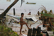 Children of Betio village play amongst up-turned boats, and garbage brought in by strong surf caused by king tides which hit the coast of the Pacific island of Kiribati. The high tides caused damage to homes and crops.The islands, and their way of life, are endangered by rising sea water levels which are eroding the fragile atoll, home to approximately 92,000 people.