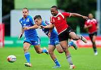 Carrado Colombo of Italy competes with Unomasa Kavita of Namibia for the ball. FISU World University Championship Rugby Sevens Men's 5th/6th place match between Namibia and Italy on July 9, 2016 at the Swansea University International Sports Village in Swansea, Wales. Photo by: Patrick Khachfe / Onside Images