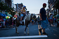 A child rides a pony wduring the National Night Out festivities in Union City, New Jersey, Aug 6, 2013. Photo by Eduardo Munoz Alvarez / VIEWpress.
